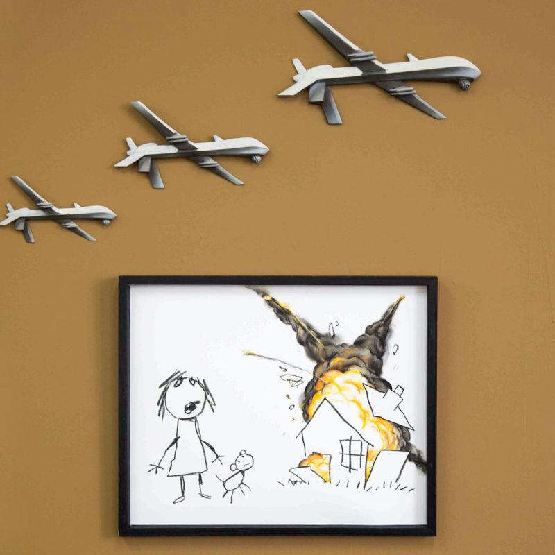 Banksy Takes aim at Arms Fair | Civilian Drone Strike for auction