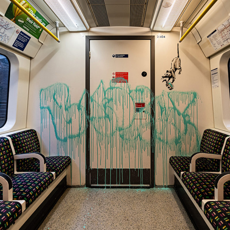 Banksy Takes to the London Underground to Remind Us to Wear a Mask